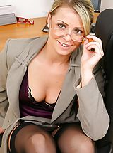 Stunning blonde secretary takes off her clothes and shows off sexy lingerie.